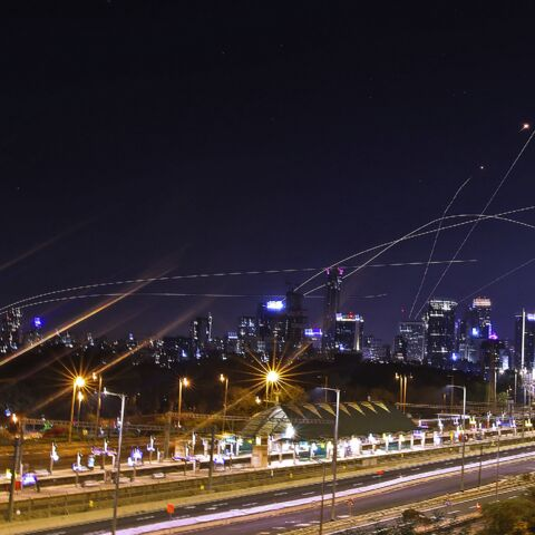 Israel's Iron Dome air defense system intercepts rockets above the coastal city of Tel Aviv on May 15, 2021, following their launching from the Gaza Strip controlled by the Palestinian Hamas movement.