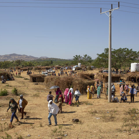 Survivors and refugees of the Benishangul-Gumuz massacre walk through the displaced persons camp in the city of Chagni, Ethiopia, Dec. 31, 2020.