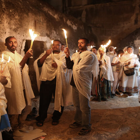 "Ethiopian Christian pilgrims hold candles during an Ethiopian Orthodox ceremony of the ""Holy Fire"" at Deir Al-Sultan Church held on the roof of the Holy Sepulcher in the Old City of Jerusalem, April 30, 2016."