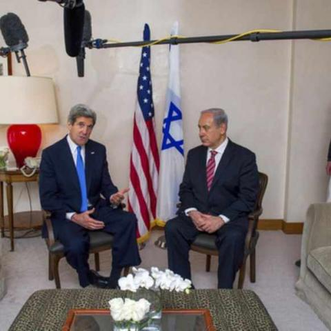 U.S. Secretary of State John Kerry (L) speaks during his meeting with Israel's Prime Minister Benjamin Netanyahu in Jerusalem April 9, 2013. REUTERS/Paul J. Richards/Pool (JERUSALEM - Tags: POLITICS) - RTXYEIP