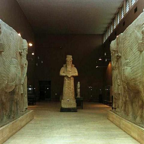 Monumental Assyrian works stand in a gallery of the Iraq Museum in Baghdad. The authorities closed the museum and removed most of its other treasures to secret hiding places during the 1990-91 Gulf crisis, but are now considering plans with UNESCO to put them back on show. (Picture taken 30NOV98) - RTXHUYE
