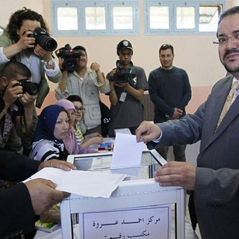 "Abdelmadjid Menasra, leader of the Islamist party Front of Change (FC), casts his ballot during parliamentary elections at a polling station in Algiers May 10, 2012. Algerians voted on Thursday for a new parliament that officials say will bring democracy to a country left behind by the ""Arab Spring"" revolts, but many people showed their scepticism by abstaining. REUTERS/Louafi Larbi  (ALGERIA - Tags: POLITICS ELECTIONS) - RTR31UYV"