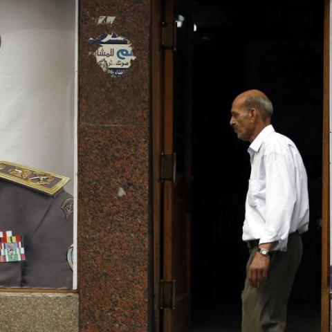People walk past posters of presidential candidate and former army chief Abdel Fattah al-Sisi at one of his campaign headquarters in central Cairo April 16, 2014. Egyptians will vote on May 26-27 in a presidential election where Abdel Fattah al-Sisi is expected to win easily. REUTERS/Amr Abdallah Dalsh   (EGYPT - Tags: POLITICS ELECTIONS) - RTR3LLFL