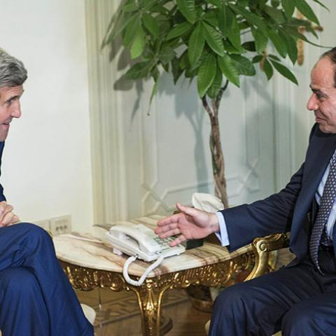 Egypt's President Abdel Fattah al-Sisi (R) and U.S. Secretary of State John Kerry talk before a meeting at the Presidential Palace in Cairo June 22, 2014. Kerry arrived in Cairo on Sunday for talks with Egypt's President Abdel Fattah al-Sisi over Egypt's crackdown on the Muslim Brotherhood and the threat which the conflict in Iraq poses to the Middle East. REUTERS/Brendan Smialowski/Pool (EGYPT - Tags: POLITICS TPX IMAGES OF THE DAY) - RTR3V3FP