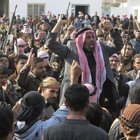 Residents gather to protest near the house of prominent Sunni Muslim lawmaker Ahmed al-Alwani, in the centre of Ramadi, December 29, 2013. Iraqi security forces arrested Alwani in a raid on his home in the western province of Anbar, sparking clashes in which at least five people were killed, police sources said. Picture taken December 29, 2013.  REUTERS/Ali al-Mashhadani (IRAQ - Tags: POLITICS CIVIL UNREST) - RTX16X7M