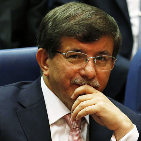 Turkey's Foreign Minister Ahmet Davutoglu attends a meeting at AK Party (AKP) headquarters in Ankara August 14, 2014. Turkish president-elect Tayyip Erdogan urged his ruling AK Party on Thursday to work for a stronger parliamentary majority next year to enable them to re-write the constitution, signalling no let-up in his drive to create an executive presidency. REUTERS/Umit Bektas (TURKEY - Tags: POLITICS) - RTR42E5X