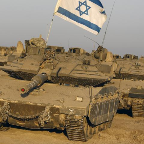 Israeli tanks are seen in a staging area near the border with the Gaza Strip August 7, 2014. Mediators worked against the clock on Thursday to extend a Gaza truce between Israel and the Palestinians as the three-day ceasefire went into its final 24 hours. Israel has said it is ready to agree to an extension as Egyptian mediators pursued talks with Israelis and Palestinians on an enduring end to a war that devastated the Hamas-ruled enclave, while Palestinians want an Israeli-Egyptian blockade of Gaza to be