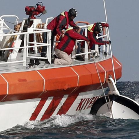 Rescuers retrieve a boat that sank off the Black Sea village of Garipce near Istanbul November 3, 2014. Rescuers pulled 24 dead bodies from the sea at the mouth of Istanbul's Bosphorus strait on Monday and rescued seven people after the boat carrying a group of migrants sank, the Turkish Coastguard Command said. Seven coastguard vessels and a helicopter were continuing search operations in the Black Sea, some 3 miles (5 km) north of the Bosphorus, the coastguard said in a statement. Media reports said some