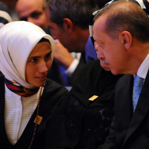 Prime Minister of Turkey, Recep Tayyip Erdogan (R) speaks with her daughter Sumeyye Erdogan, during the 125th Session of the International Olympic Committee (IOC), in Buenos Aires, on September 7, 2013. The host of the 2020 Olympic Games will be contested between Tokyo and Istanbul in a second round of voting after Madrid was eliminated in dramatic fashion from the race after the first round of voting by International Olympic Committee (IOC) members.  AFP PHOTO / DANIEL GARCIA        (Photo credit should re