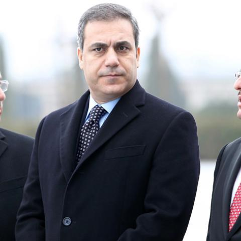 This file picture taken on December 19, 2014 shows the head of Turkey's intelligence agency Hakan Fidan (C) standing in Ankara. The powerful head of Turkey's intelligence agency, one of the most loyal allies of President Recep Tayyip Erdogan, has resigned to stand for election as a lawmaker, the official Anatolia news agency said on February 7, 2015. The resignation of Hakan Fidan, who has headed the National Intelligence Agency (MIT) since 2010, has been accepted by Prime Minister Ahmet Davutoglu and will