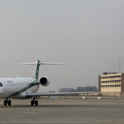 An Iraqi Airways plane lands at Baghdad International airport January 27, 2015. Airlines from at least three countries suspended flights to Baghdad on Tuesday after bullets hit an airplane operated by budget carrier Dubai Aviation Corp, known as flydubai, as it was landing at Baghdad airport. Company officials said Iraqi Airways and Iran's Caspian Airlines were operating flights to Baghdad on a normal schedule. REUTERS/Thaier Al-Sudani (IRAQ - Tags: CIVIL UNREST POLITICS TRANSPORT) - RTR4N5YY