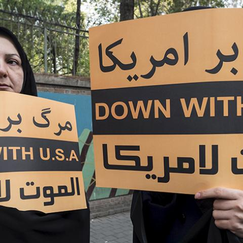 Women hold anti-U.S. banners during a demonstration outside the former U.S. embassy in Tehran November 4, 2015. REUTERS/Raheb Homavandi/TIMA ATTENTION EDITORS - THIS IMAGE WAS PROVIDED BY A THIRD PARTY. FOR EDITORIAL USE ONLY. - RTX1UOX7