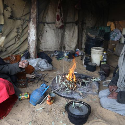 Palestinian Bedouins sit in a tent around woodfire to warm up in a Bedouin area south of Gaza City on January 7, 2015 as a major storm dumped heavy rain, high winds and snowfall on parts of the Middle East. AFP PHOTO/ MAHMUD HAMS        (Photo credit should read MAHMUD HAMS/AFP/Getty Images)