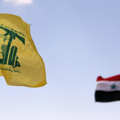 Hezbollah and Syrian flags are seen fluttering in Fleita, Syria August 2, 2017. REUTERS/ Omar Sanadiki - RC15E3E7FA20