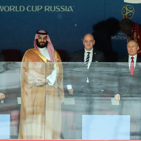 MOSCOW, RUSSIA - JUNE 14:  Mohammed bin Salman of Saudi Arabia, FIFA President Gianni Infantino and President Wladimir Putin of Russia look on during the 2018 FIFA World Cup Russia group A match between Russia and Saudi Arabia at Luzhniki Stadium on June 14, 2018 in Moscow, Russia.  (Photo by Amin Mohammad Jamali/Getty Images)