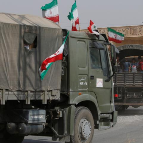 Iranian and Syrian flags flutter on a truck carrying humanitarian aid in Deir al-Zor, Syria September 20, 2017. Picture taken September 20, 2017. REUTERS/Omar Sanadiki - RC1C8E382200