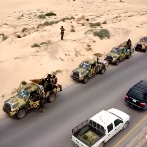 An aerial view shows military vehicles on a road in Libya, April 4, 2019, in this still image taken from video. Reuters TV via REUTERS - RC1720685A20
