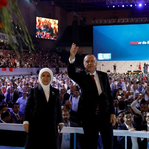 Turkish President Tayyip Erdogan, accompanied by his wife Emine Erdogan, greets his supporters during the sixth Congress of the ruling AK Party (AKP) in Ankara, Turkey, August 18, 2018. REUTERS/Umit Bektas - RC163D352FB0