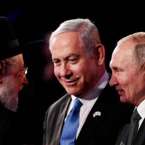 Rabbi Israel Meir Lau Chairman of the Yad Vashem Council speaks to Israeli Prime Minister Benjamin Netanyahu and Russian President Vladimir Putin at the World Holocaust Forum marking 75 years since the liberation of the Nazi extermination camp Auschwitz, at Yad Vashem Holocaust memorial centre in Jerusalem January 23, 2020. REUTERS/Ronen Zvulun/Pool - RC2RLE9EVQ76