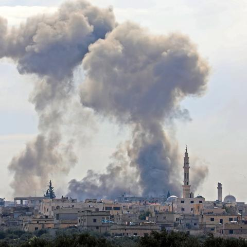 This picture taken on February 3, 2020 shows smoke plumes billowing in the Syrian village of al-Nayrab, about 14 kilometres southeast of the city of Idlib in the northwestern Idlib province, during bombardment by Syrian government forces and its allies. (Photo by Omar HAJ KADOUR / AFP) (Photo by OMAR HAJ KADOUR/AFP via Getty Images)