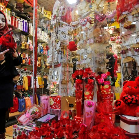 A woman searches for a gift for Valentine's Day at a gift shop in Mosul, Iraq February 13, 2019. Picture taken February 13, 2019. REUTERS/Khalid al-Mousily - RC18AACF06B0