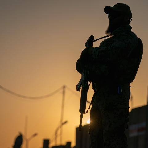 20 August 2019, Iraq, Bagdad: A soldier of the German Armed Forces is standing at dusk with his weapon on the verge of the German Defence Minister's visit to the international military camp Camp Taji. The minister and CDU leader is conducting political talks in the capital Baghdad and is meeting German soldiers who are involved in training local forces in the country. Photo: Michael Kappeler/dpa (Photo by Michael Kappeler/picture alliance via Getty Images)