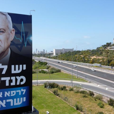 "A billboard of Israeli Parliament speaker Benny Gantz is pictured along a highway in the Mediterranean costal city of Tel Aviv, on March 29, 2020. - Israeli Prime Minister Benjamin Netanyahu and his erstwhile rival Benny Gantz announced ""significant progress"" in talks towards forming an emergency unity government amid the novel coronavirus pandemic. (Photo by JACK GUEZ / AFP) (Photo by JACK GUEZ/AFP via Getty Images)"