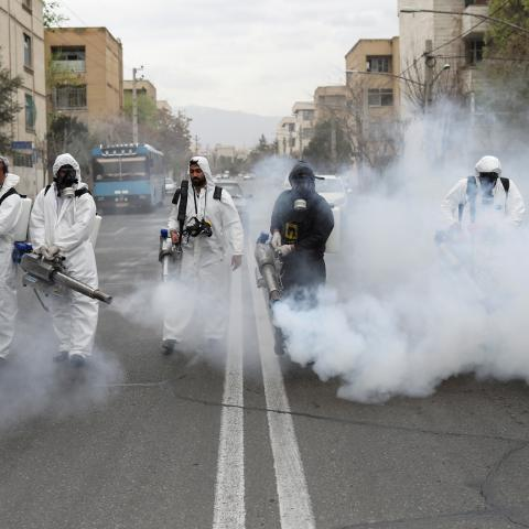Members of firefighters wear protective face masks, amid fear of coronavirus disease (COVID-19), as they disinfect the streets, ahead of the Iranian New Year Nowruz, March 20, in Tehran, Iran March 18, 2020. Picture taken March 18, 2020. WANA (West Asia News Agency)/Ali Khara via REUTERS ATTENTION EDITORS - THIS PICTURE WAS PROVIDED BY A THIRD PARTY     TPX IMAGES OF THE DAY - RC23NF9FQH2G
