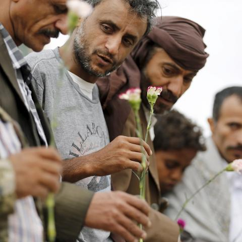 Members of the Baha'i faith hold flowers as they demonstrate outside a state security court during a hearing in the case of a fellow Baha'i man charged with seeking to establish a base for the community in Yemen, in the country's capital Sanaa April 3, 2016. REUTERS/Khaled Abdullah - GF10000369865