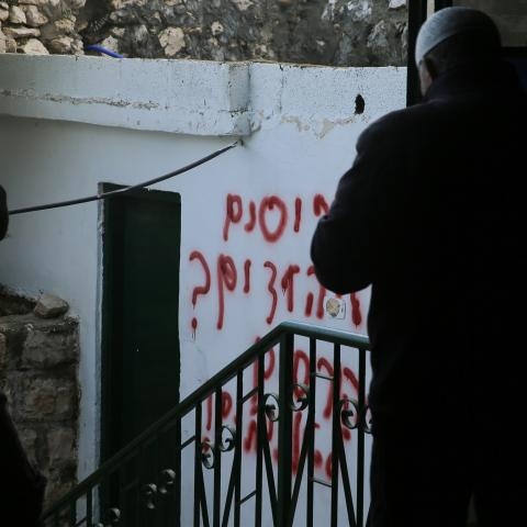 JERUSALEM - JANUARY 24 : A view of Hebrew racial slurs on the wall of the mosque sprayed by Jewish settlers as eyewitnesses reported that a group of settlers set fire to the Badriya mosque in Beit Safafa town in Jerusalem on January 24, 2020. (Photo by Mostafa Alkharouf/Anadolu Agency via Getty Images)