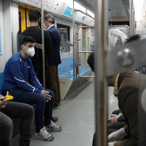 People wear protective face masks, following the outbreak of coronavirus, as they sit in a metro in Tehran, Iran March 17, 2020. WANA (West Asia News Agency)/Ali Khara via REUTERS ATTENTION EDITORS - THIS PICTURE WAS PROVIDED BY A THIRD PARTY - RC2PLF9NILL2