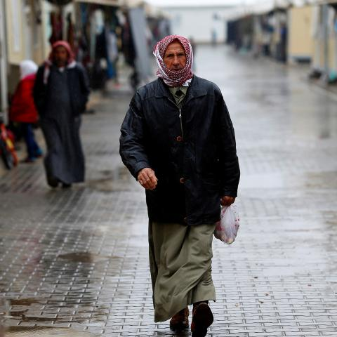 A Syrian refugee man walks in Elbeyli refugee camp near the Turkish-Syrian border in Kilis province, Turkey, December 1, 2016. REUTERS/Umit Bektas - RC118F65CE00