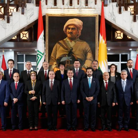 Members of the new cabinet of the Kurdistan parliament headed by Prime Minister Masrour Barzani pose for a family photo, in Erbil, Iraq July 10, 2019. REUTERS/Azad Lashkari - RC1B64599A60