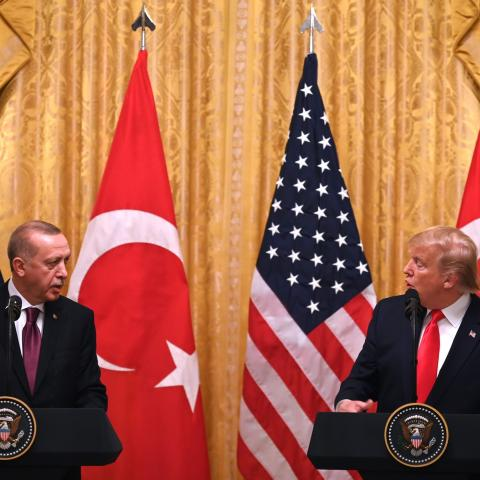 US President Donald Trump and Turkey's President Recep Tayyip Erdogan (L) take part in a joint press conference in the East Room of the White House in Washington, DC on November 13, 2019. - President Donald Trump greeted his Turkish counterpart Recep Tayyip Erdogan at the White House for a high-stakes meeting Wednesday that underlined his claim to be ignoring the impeachment drama unfolding simultaneously in Congress. (Photo by JIM WATSON / AFP) (Photo by JIM WATSON/AFP via Getty Images)