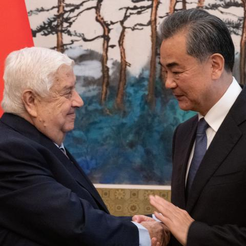 Syrian Foreign Minister Walid Muallem (L) shakes hands of Chinese Foreign Minister Wang Yi (R)  after a press conference at Diaoyutai state guesthouse in Beijing on June 18, 2019. Fred Dufour/Pool via REUTERS - RC1583F62660