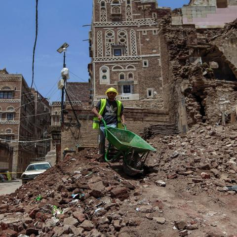 A Yemeni labourer removes the rubble ahead of restoration works on the site of a collapsed UNESCO-listed building following heavy rains, in the old city of the Yemeni capital Sanaa, on August 12, 2020. - Flash floods triggered by torrential rains have killed at least 172 people across Yemen over the past month, damaging homes and UNESCO-listed world heritage sites, officials said. (Photo by Mohammed HUWAIS / AFP) (Photo by MOHAMMED HUWAIS/AFP via Getty Images)