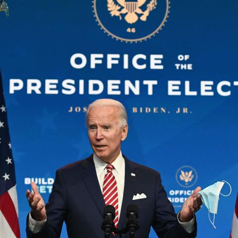 "US President-elect Joe Biden shows a face mask as he answers questions about COVID 19 from the press at The Queen in Wilmington, Delaware on November 16, 2020. - US President-elect Joe Biden expressed frustration on November 16, 2020 about Donald Trump's refusal so far to cooperate on the White House transition process, saying ""more people may die"" without immediate coordination on fighting the coronavirus pandemic. (Photo by ROBERTO SCHMIDT / AFP) (Photo by ROBERTO SCHMIDT/AFP via Getty Images)"