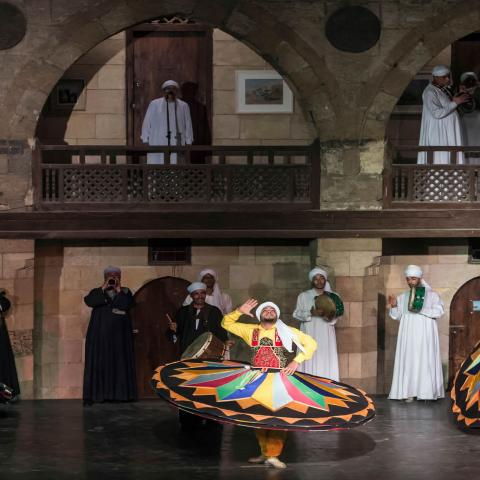 Egyptian dancers perform the Tanoura during the holy fasting month of Ramadan, at el-Ghuri culture Palace in Cairo on May 22, 2018. (Photo by KHALED DESOUKI / AFP)        (Photo credit should read KHALED DESOUKI/AFP via Getty Images)