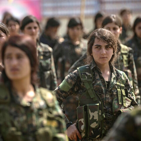 Fighters from the Kurdish Women's Protection units (YPJ) participate in a military parade on March 27, 2019, celebrating the total elimination of the Islamic State (IS) group's last bastion in eastern Syria, in the northwestern city of Hasakah, in the province of the same name. (Photo by Delil SOULEIMAN / AFP)        (Photo credit should read DELIL SOULEIMAN/AFP via Getty Images)