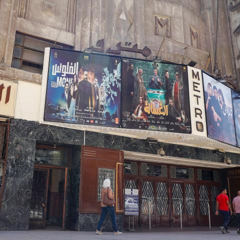 This picture taken on August 26, 2020 shows a view of the historic Metro cinema theatre along the commercial Talaat Harb street in the city centre of Egypt's capital Cairo. - Egyptian cinemas are slowly reopening after months of lockdown, but the huge sector sometimes dubbed the Hollywood of the Arab world has taken a severe hit during the pandemic. After most studios, sets and movie theatres were shuttered because of COVID-19 from at least March to June, filmmakers and the wider sector are bracing for an u