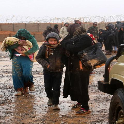 Syrian refugee patients from the makeshift Rukban camp, which lies in no-man's-land off the border between Syria and Jordan in the remote northeast, cross over to visit a UN-operated medical clinic immediately on the Jordanian-side for checkups, on March 1, 2017. Conditions in the Rukban camp deteriorated sharply after Jordan sealed its border almost a year prior, following a cross-border jihadist attack that killed seven Jordanian border guards in June 2016. / AFP PHOTO / KHALIL MAZRAAWI        (Photo cred