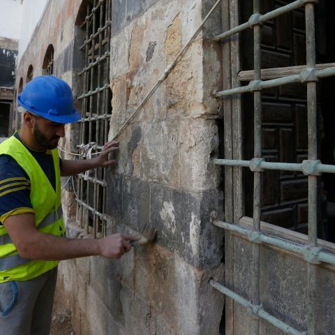 Workers restore a palatial Ottoman-era home called Beit al-Quwatli to turn it into a cultural institution  in the old part of Syria's capital Damascus on November 10, 2020. - The old city of the Syrian capital is famed for its elegant century-old houses, usually two storeys built around a leafy rectangular courtyard with a carved stone fountain at its centre. While the capital has been largely spared the violence of Syria's almost ten-year war, several of these traditional homes have been abandoned by their